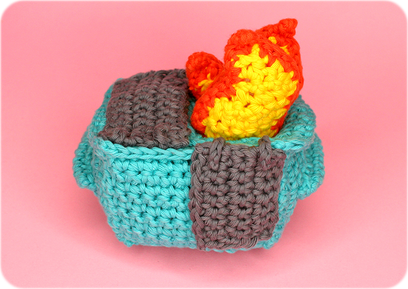 back view of crocheted dumpster fire